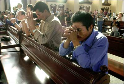 People praying to god in church